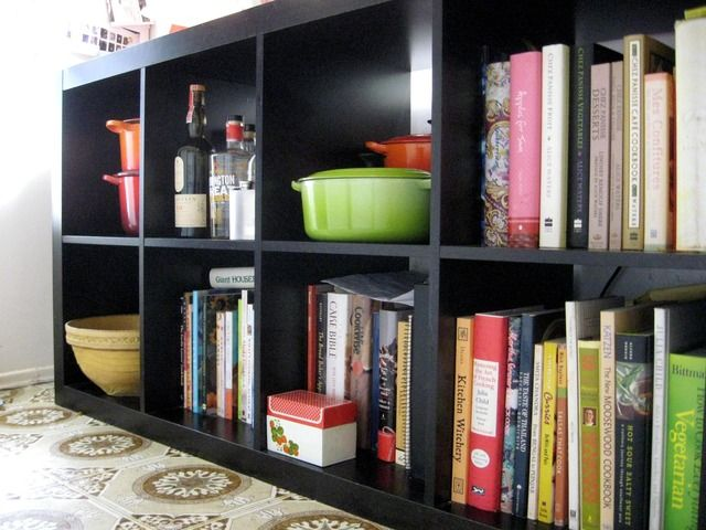 Love this bookcase! Good idea for pics & candles!