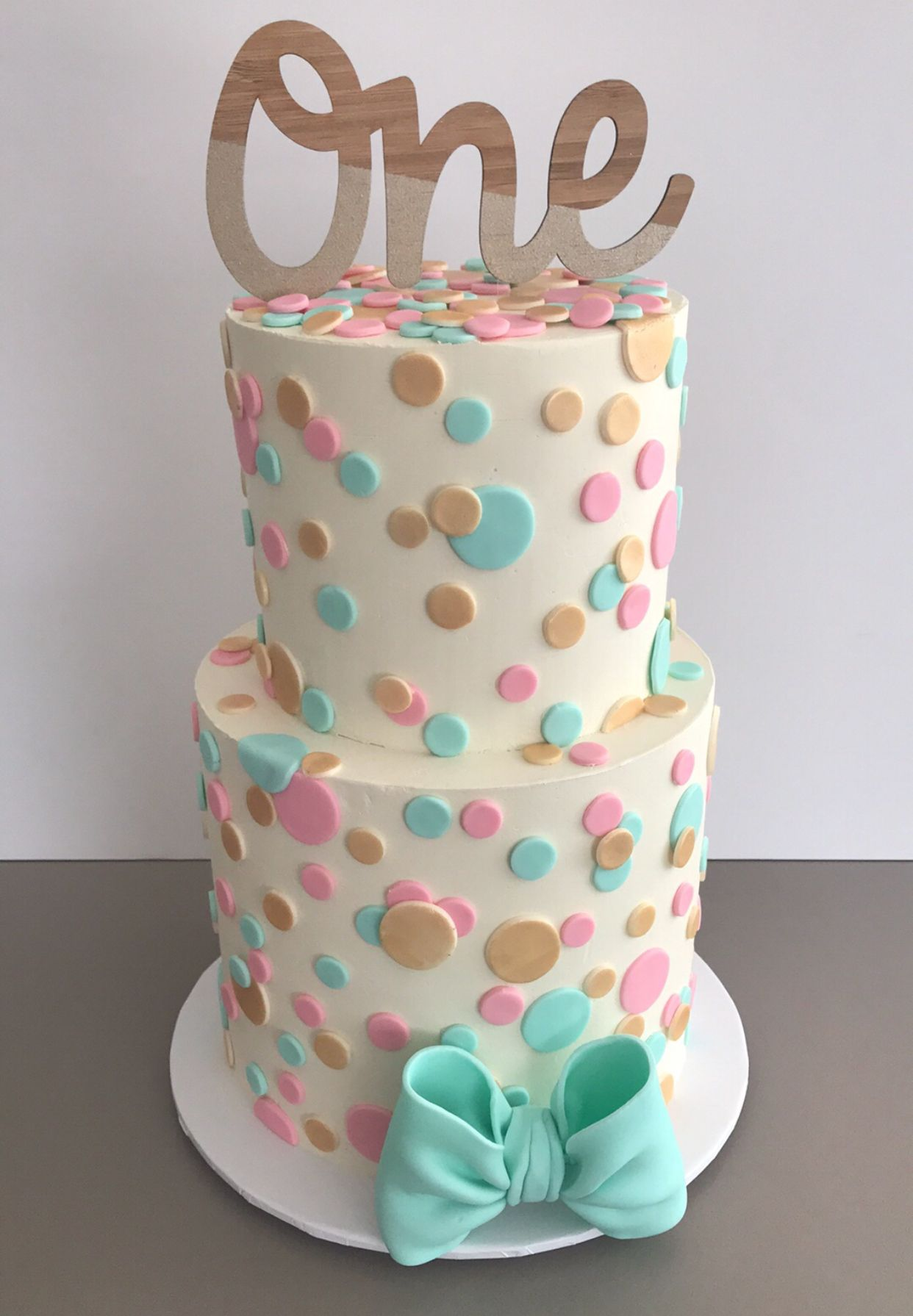 Polka Dot First Birthday Cake Featuring An Arloandco One Topper