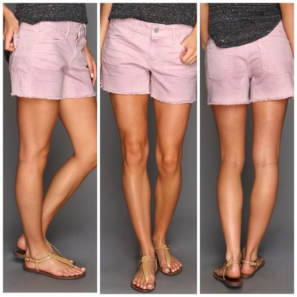 levis | dusty lilac | cutoff shorts Levi's® Cut Off Shorts start the season off right with effortless cool. corduroy shorts feature an easy cut to the frayed cut-off hem. mid rise hits at the natural waist.  five-pocket design with signature arcuate stitch at back. belt loop waistband. zip fly and button closure.  size 26 Levi's Jeans
