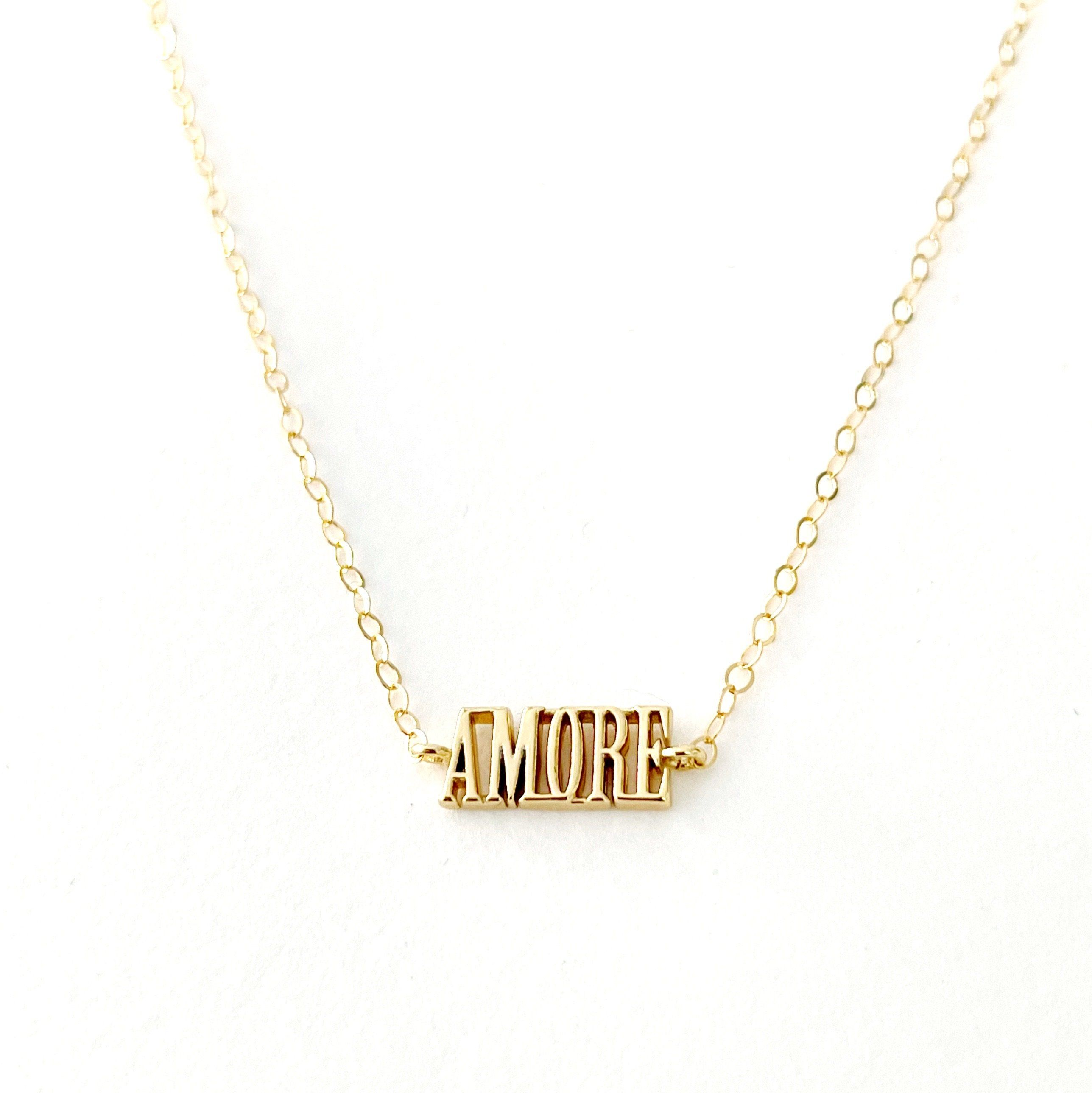 This dainty block letter necklace says love in Italian. Makes a lovely gift or wear it yourself as the perfect everyday necklace. -Gold filled chain measures 18 inches long -Spring ring clasp -Made in California