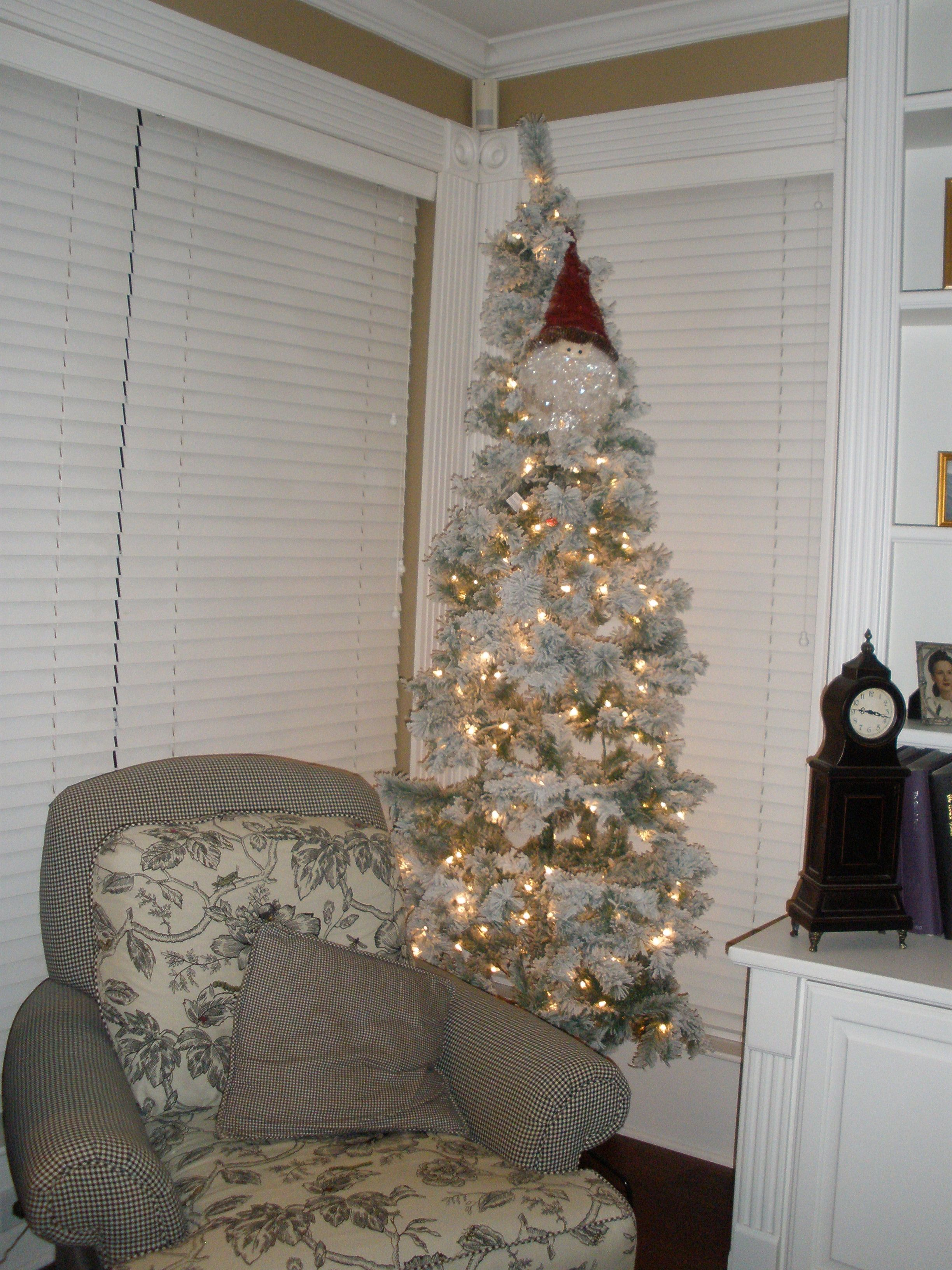 My tall skinny flocked tree- just white lights and Santa ...