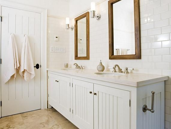 Crisp White Cottage Beachy Bathroom Design With White Beadboard Bathroom Cabinets Vanity Double Sinks Marble Counter Tops Rustic Wood Mirrors Stone Tiles Fl Beadboard Bathroom Cottage Bathroom White Beadboard