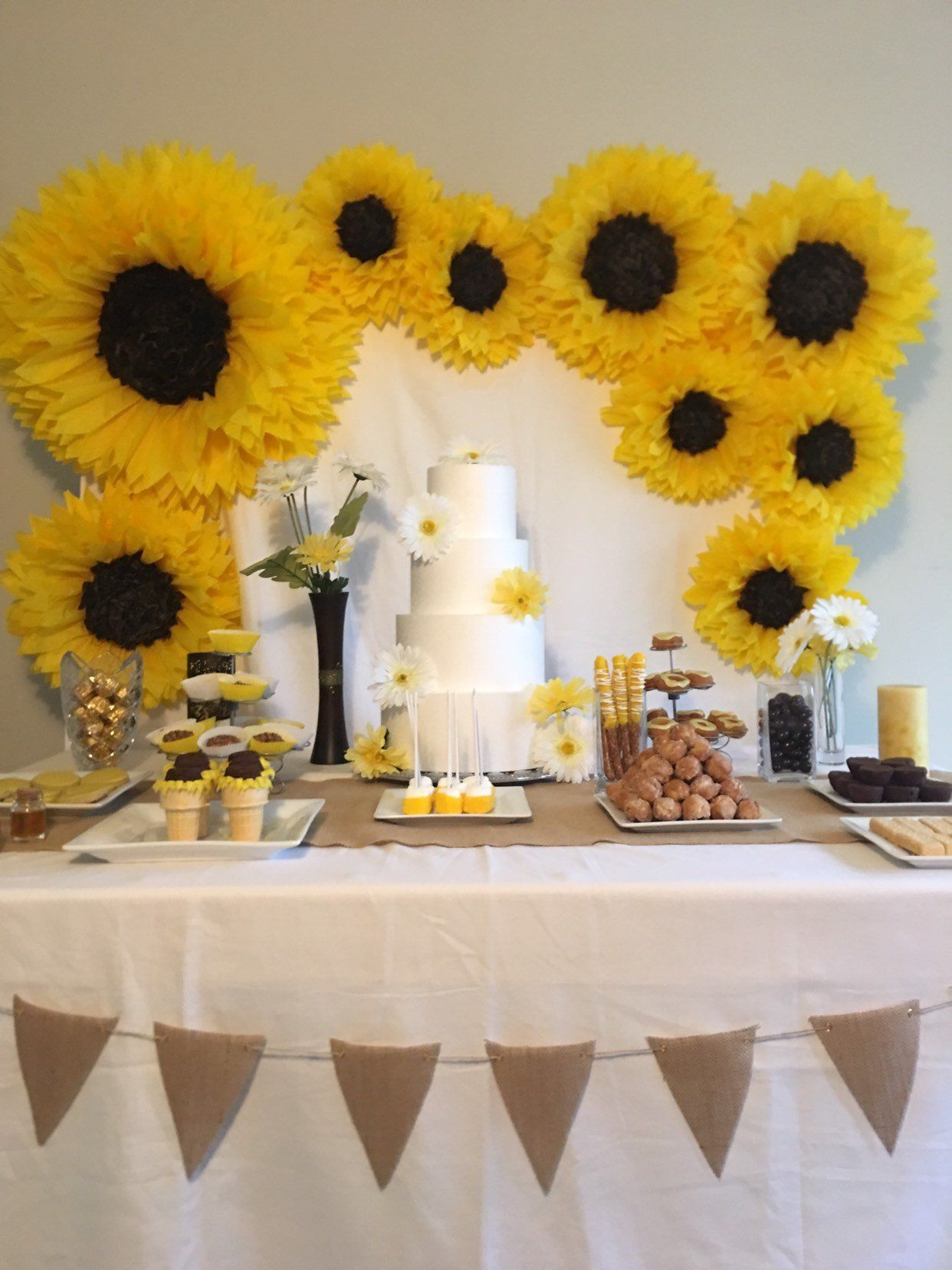 Oversized paper sunflower backdrop for rustic weddings