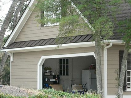 Decorative metal roof over garage door framed with for Garage overhang