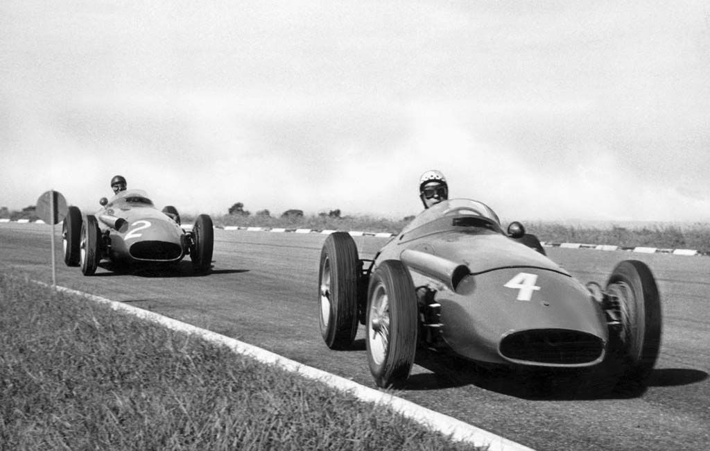 Behra and Fangio dueling in Maserati 250Fs