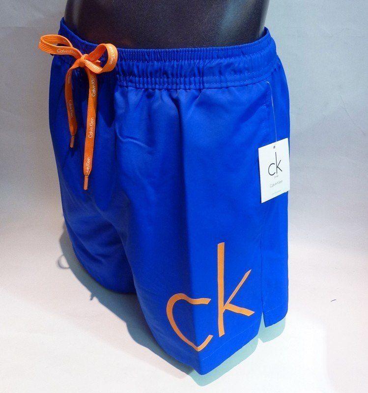 Bañador Logo Printed Calvin Klein - K9MN000209 B53 - Corte clásico y largo de pierna medio. Lleva logo CK, en naranja, en el bajo inferior de la pierna izquierda. ENVÍO 24/48 - #bañadores http://www.varelaintimo.com/categoria/37/boxers