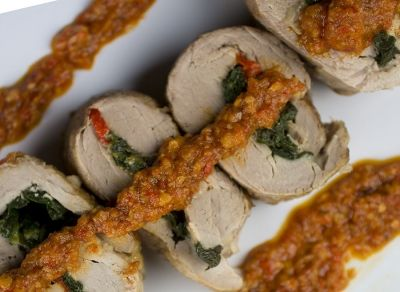 A Spanish style pork tenderloin stuffed with spinach, Manchego cheese and roasted peppers, then served with Romesco sauce.