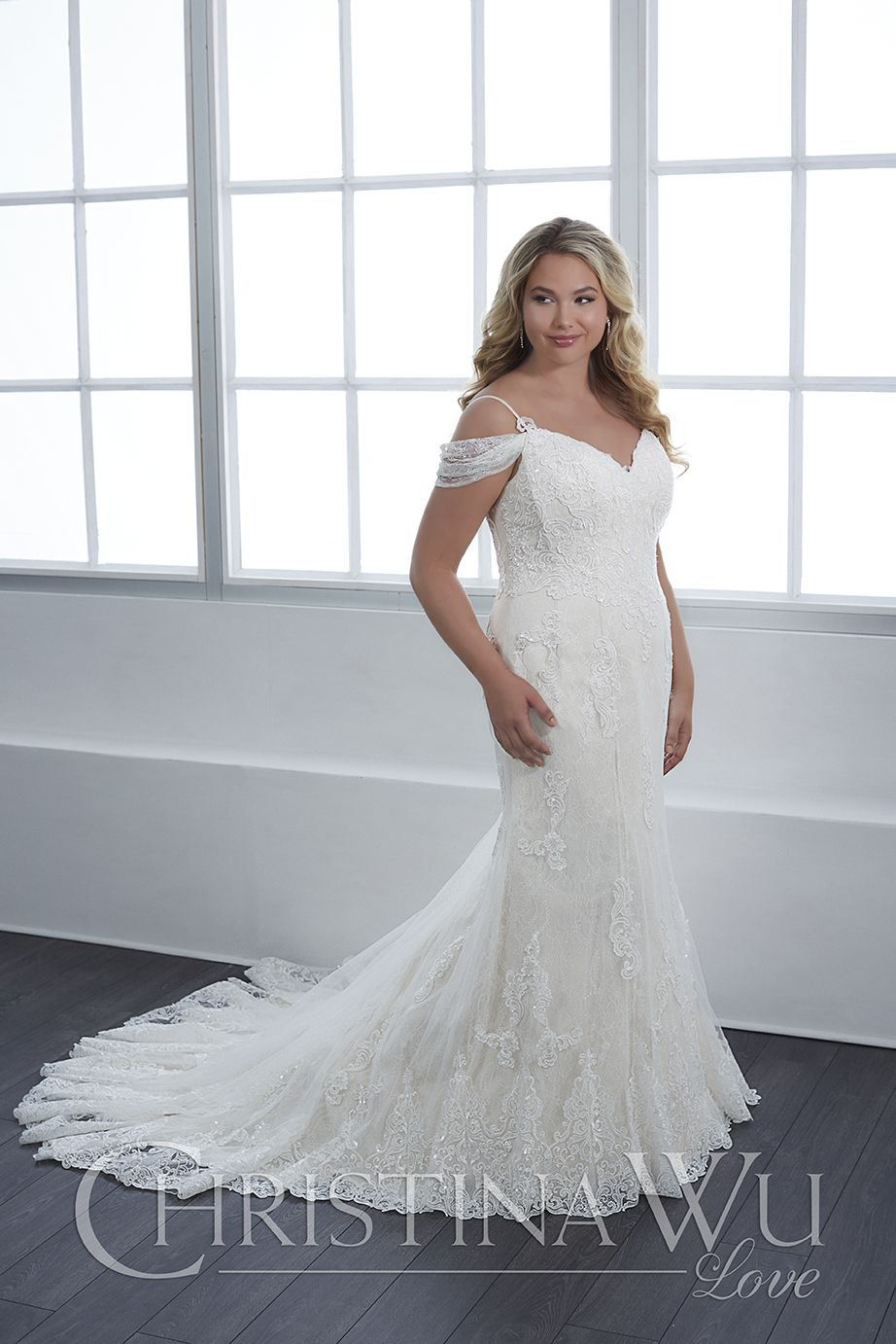This Christina Wu Love 29306 fitted plus size wedding gown