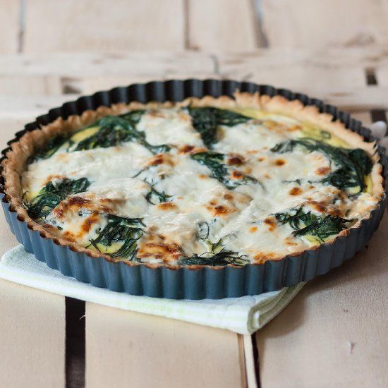 Quiche with vegetables and cheese