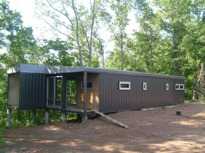 Home eleven amazing shipping container homes isbu for Shipping container pier foundation