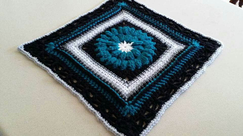 http://simplycollectiblecrochet.com/2015/03/whimsical-penelopes-free-12-inch-square-crochet-pattern/