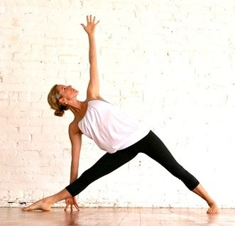 triangle pose tuck the back toes under and spin the left