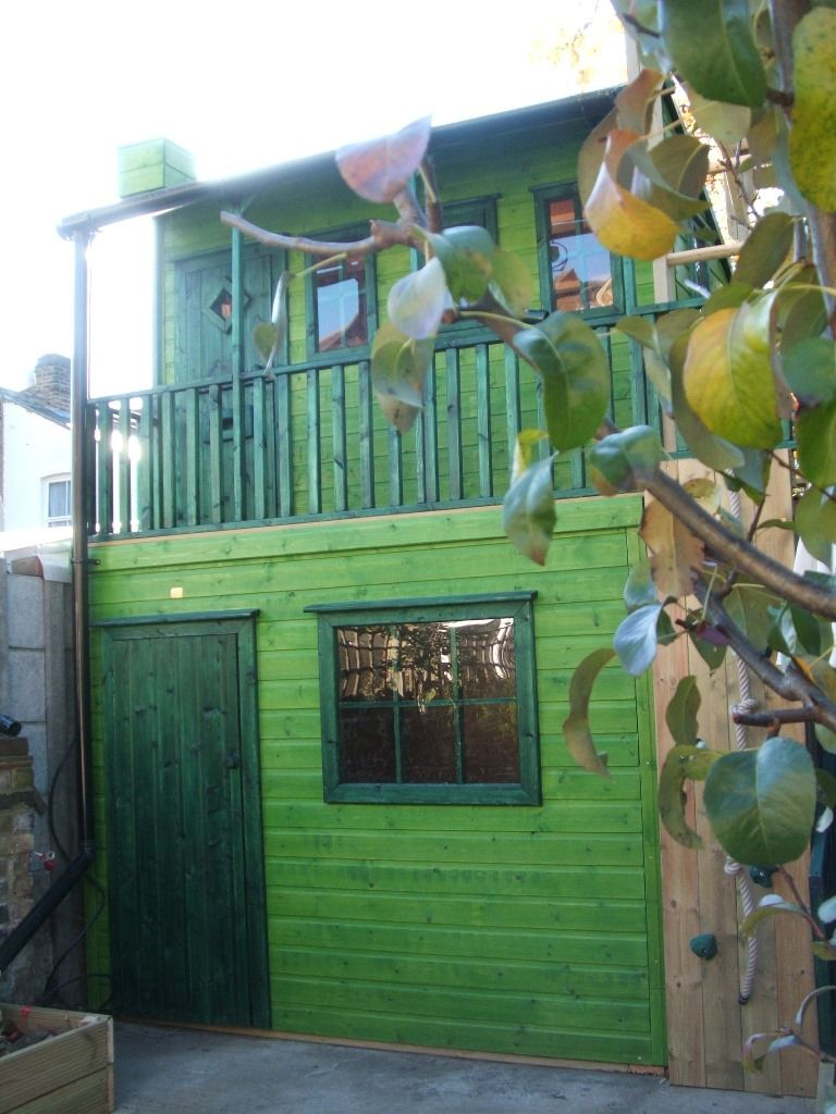 Childrens Raised Playhouse With Storage Shed