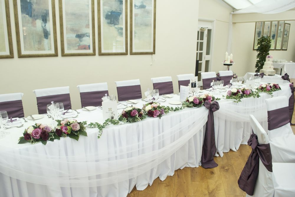 Top Table Decoration With Dusky Pink Roses And Trailing Ivy