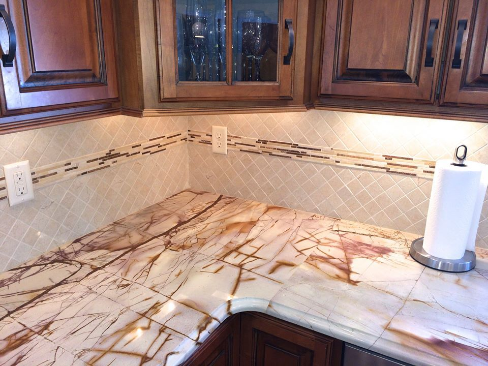 Close Up Of The Roma Imperiale Quartzite Countertop And The Newly Installed Crema Marfil Porcelain Tile Back Sp Quartzite Countertops Countertops Quartzite