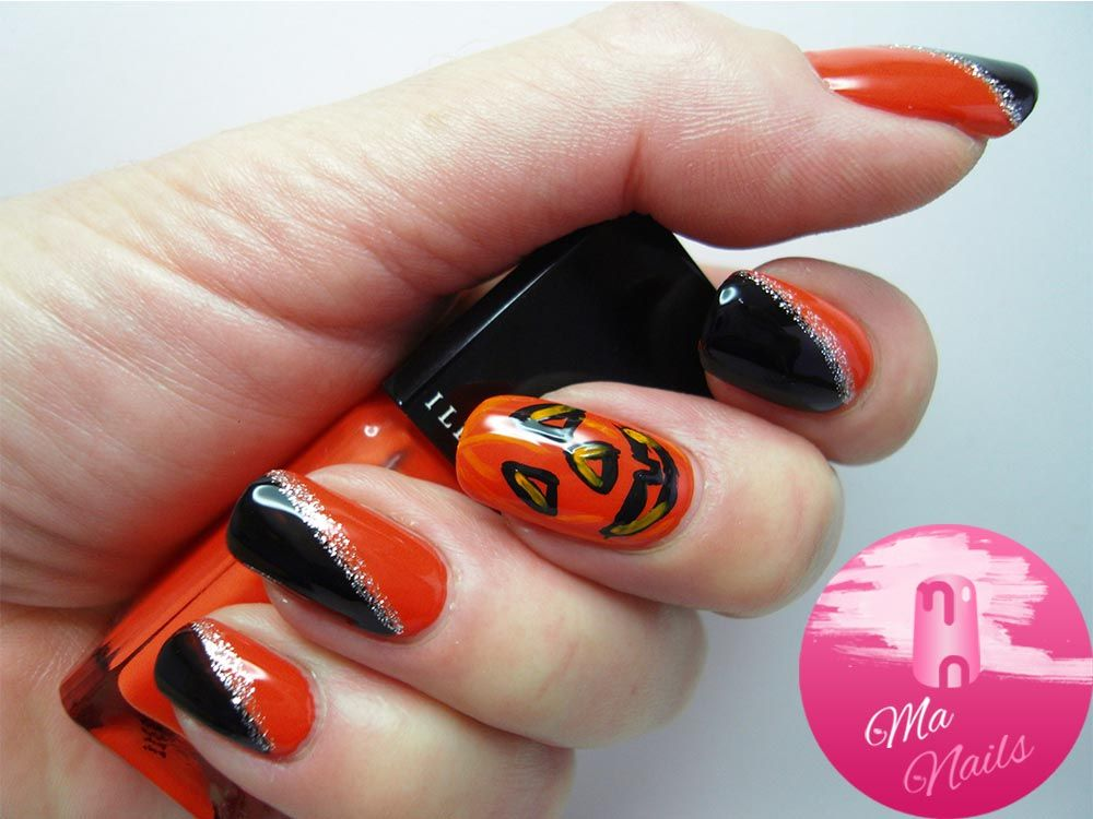 Black and Orange Nails with Pumpkin Accent is a simple yet