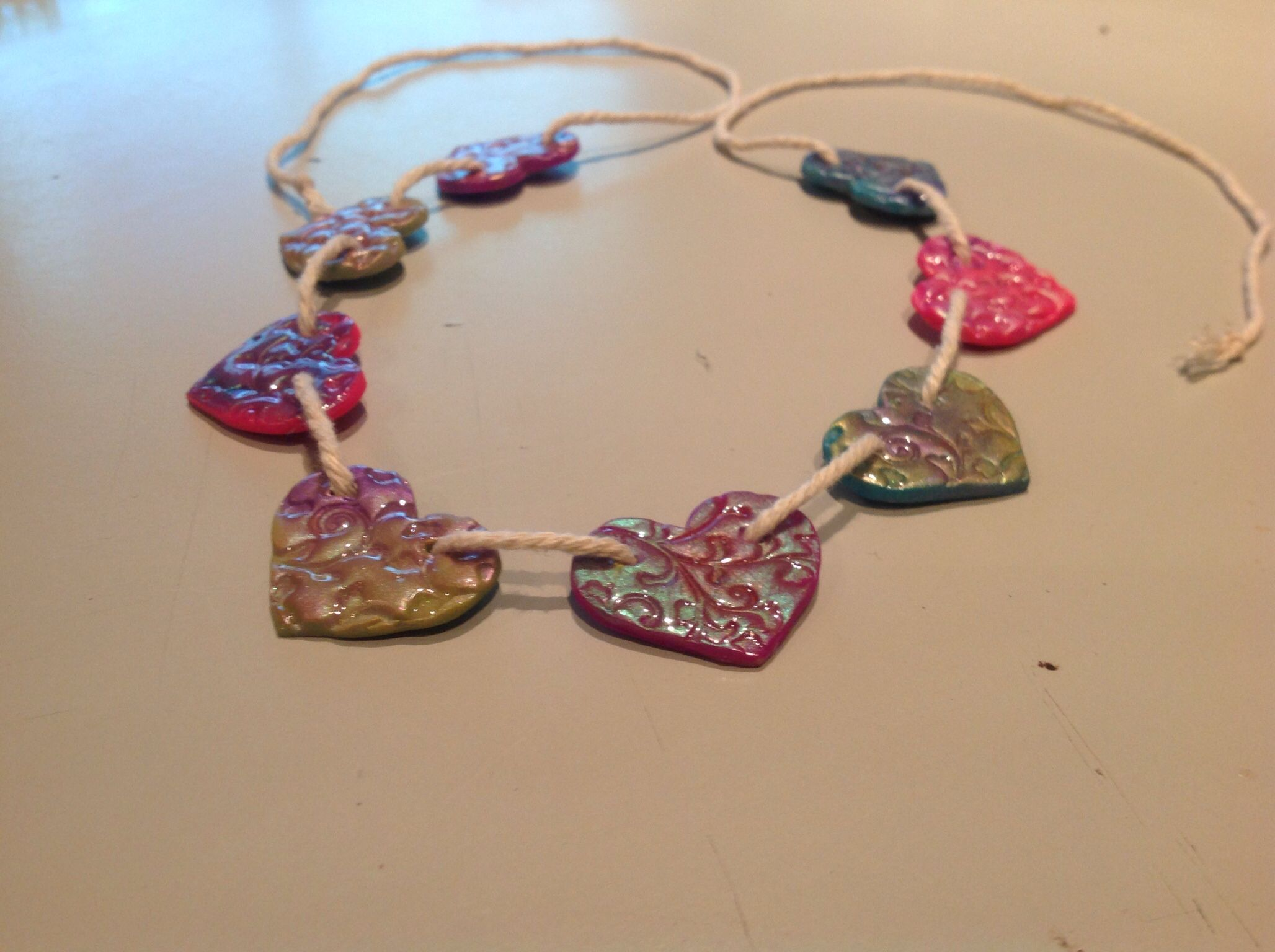 Polymer clay <3 garland made by my 3 year old daughter, she stamp the clay and decorate It with mica powder...