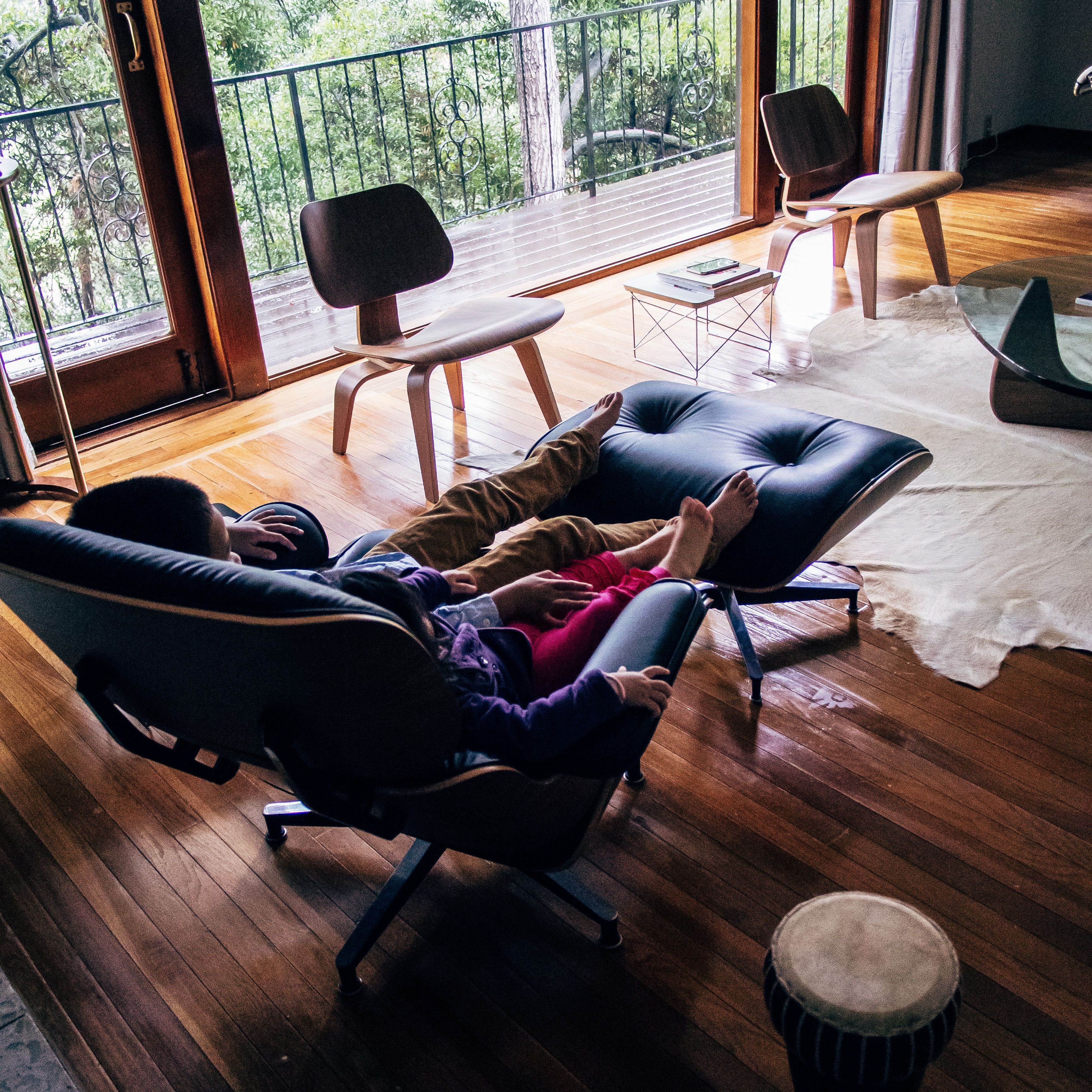 Haven't pinterest in a while. My two kids lounging together on a heavy rainy Sunday morning in an Eames 670/671 Lounge. Enjoying the music of the rain drops together.