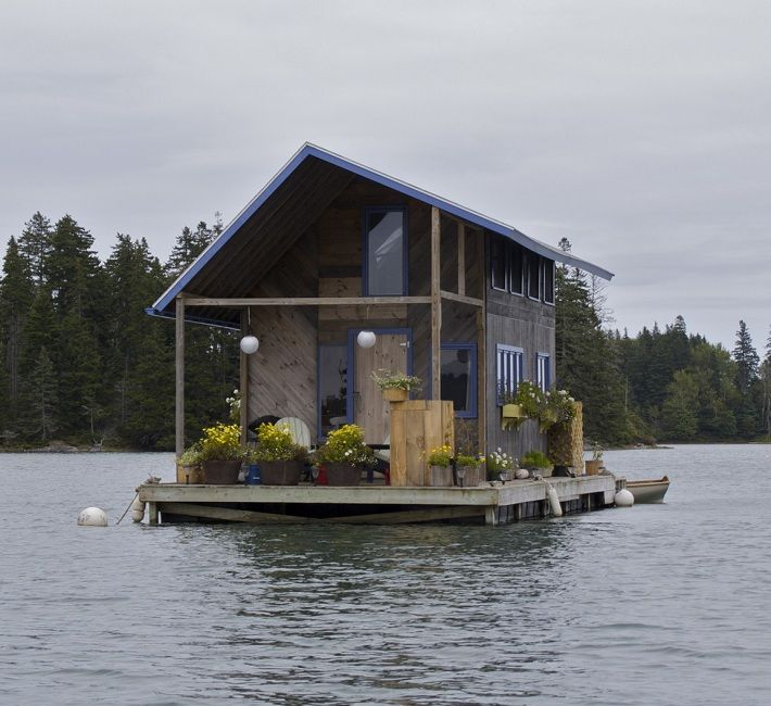 A custom built floating cabin in perry creek nearby the for Minimalist house boat