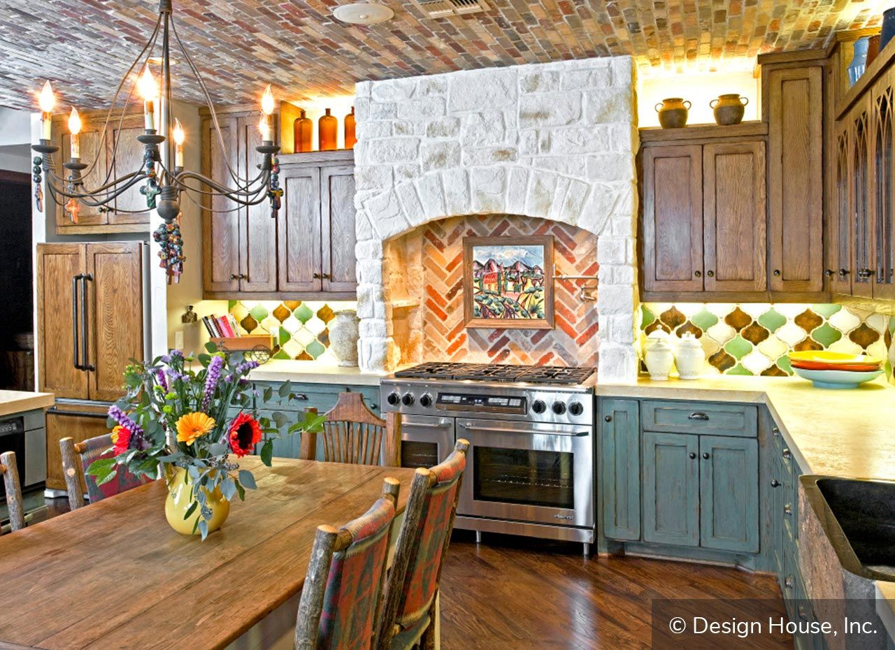 For A Rustic Spanish Style Look Mix A Variety Of Colors And Patterns Throughout The Kitchen Traditional Kitchen Cabinets Spanish Style Kitchen Rustic Kitchen