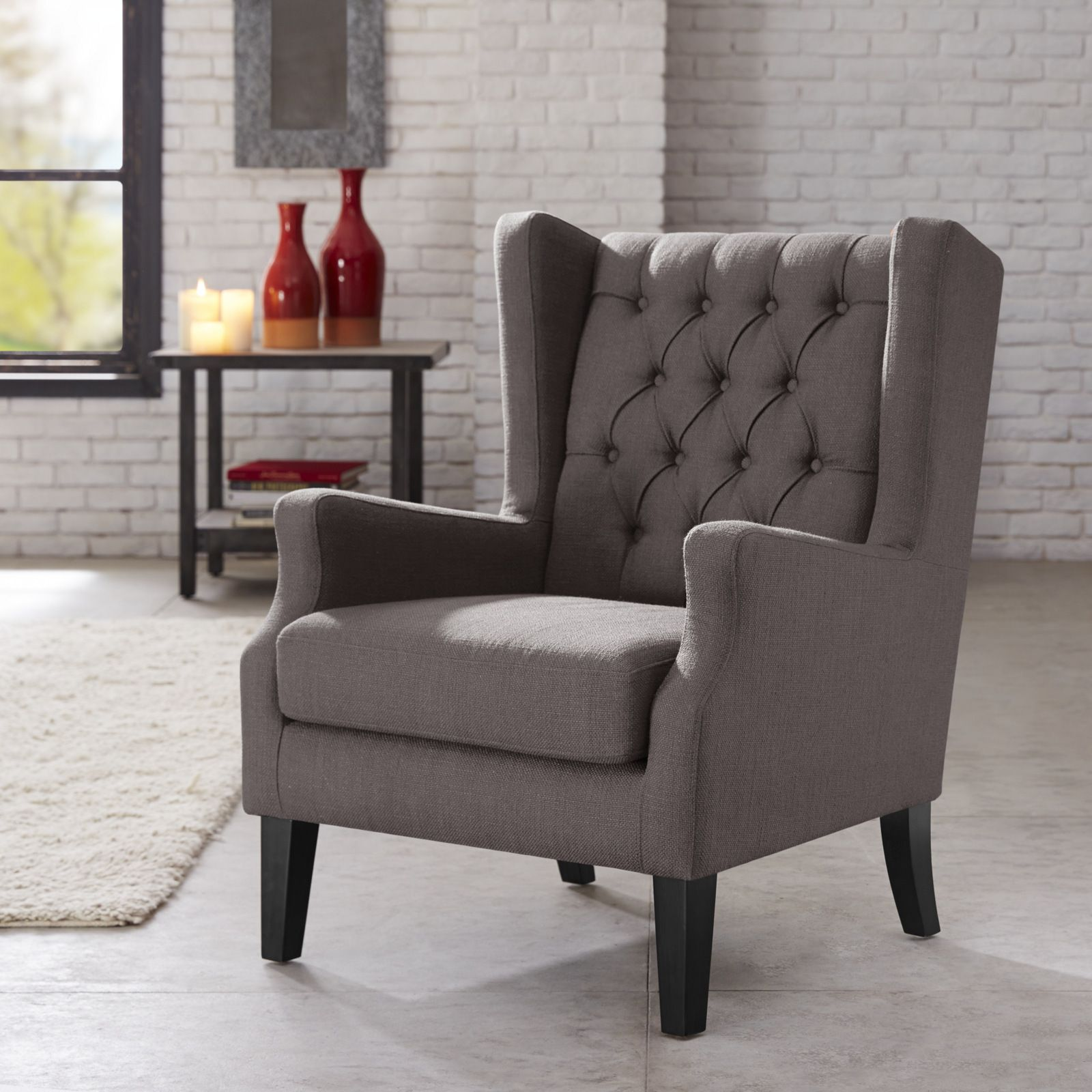 this classic wing chair with its button tufted detailing and sloped arms adds a casual twist