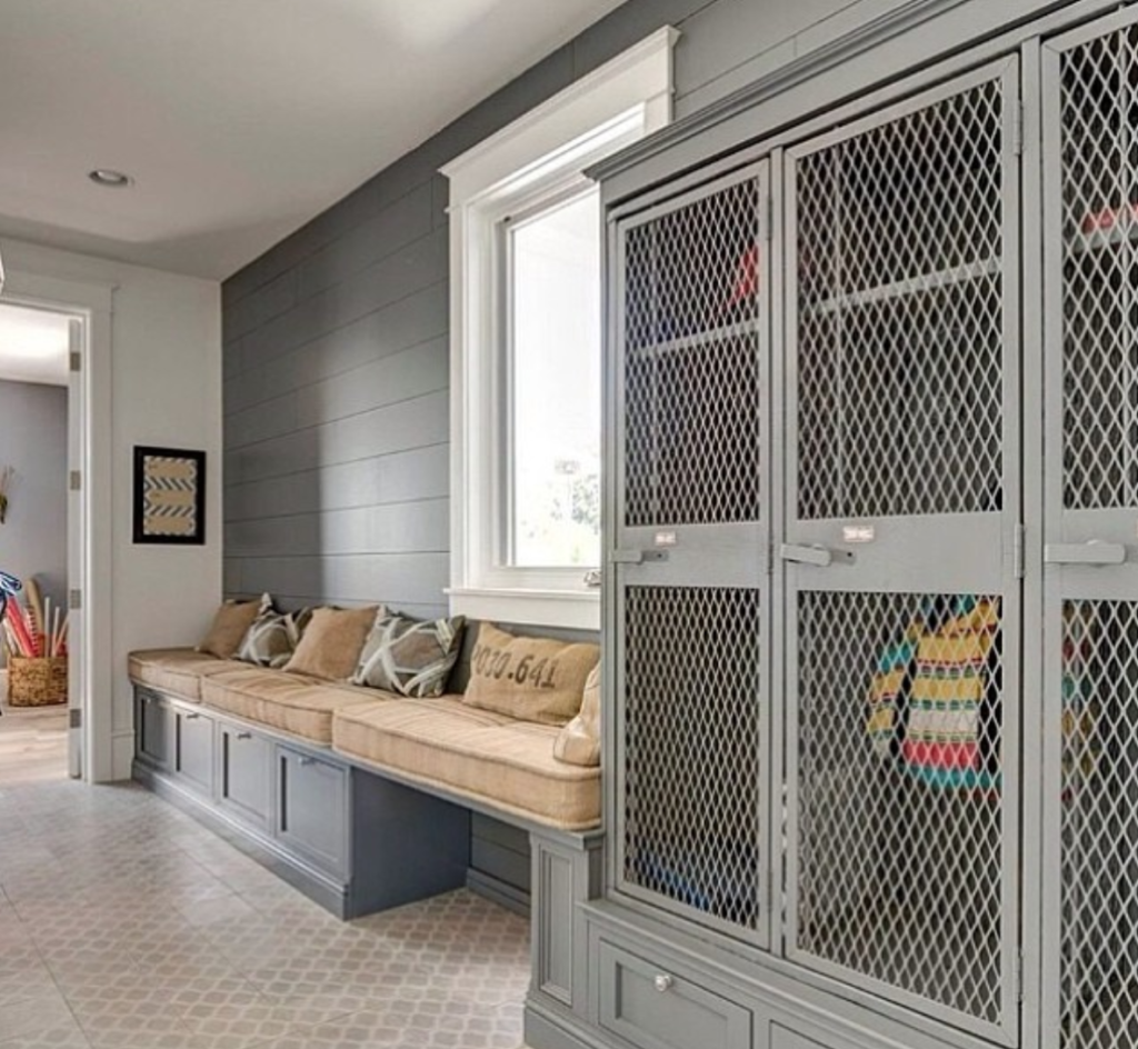 15 Inspiring Laundry + Mudroom Design Ideas- Mudroom with metal lockers and bench with cushion