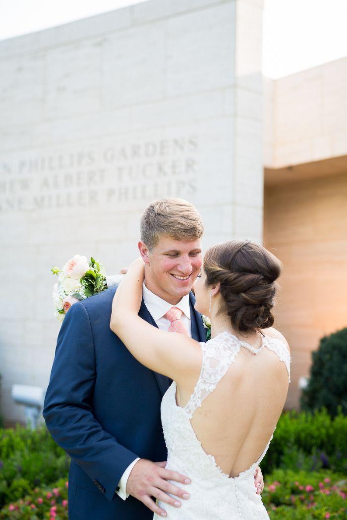 Jule Collins Smith Museum groom smiling as he stares into his bride's eyes Wedding Photos | Auburn, AL