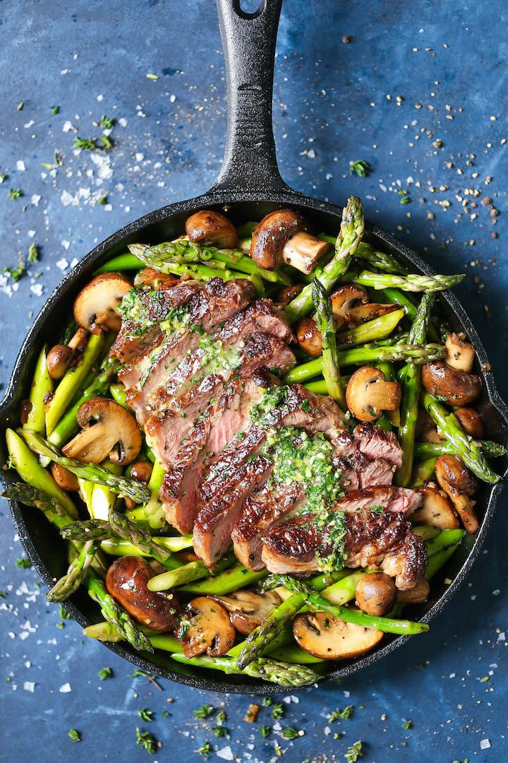 One Pan Steak and Veggies with Garlic Herb Butter - Perfectly seasoned and cooked steak with asparagus and mushrooms, served with a heavenly garlic herb butter! One pan. Minimal clean-up. 30 minutes. That's it!