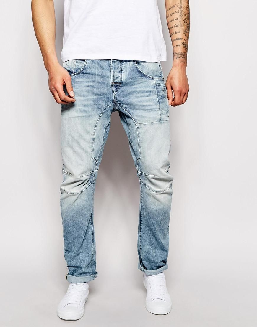 Jeans by Jack & Jones Faded, light wash denim Low-rise waist Button fly  fastening Five pocket styling Twisted seams Tapered leg Slim fit - cut  closely to ...