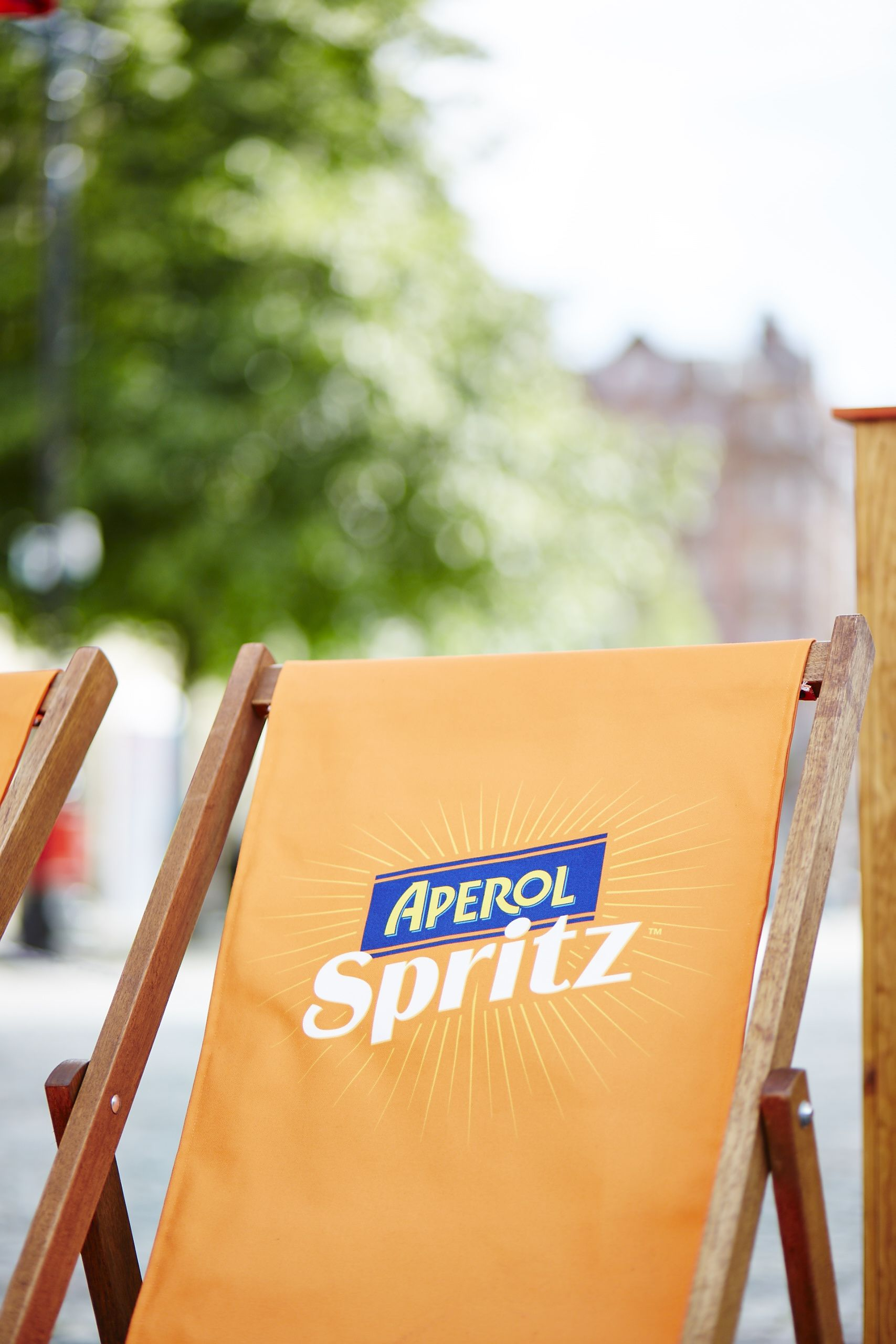 e of the best parts of an Aperol Spritz Social deck chairs