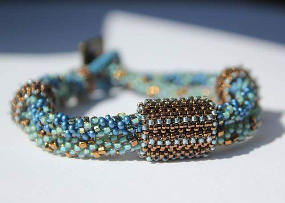 Hand Beaded Kumihimo Blue, Green and Bronze Bracelet with hand beaded beads and Brass button clasp on Etsy, $75.00