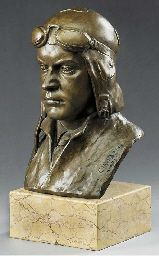A fine large sculpted bust of a pilot wearing flying helmet and goggles, signed and dated by the artist sculptor 1932; cast bronze surmonting a polished marble plinth. Height 55 cm (21 ins).