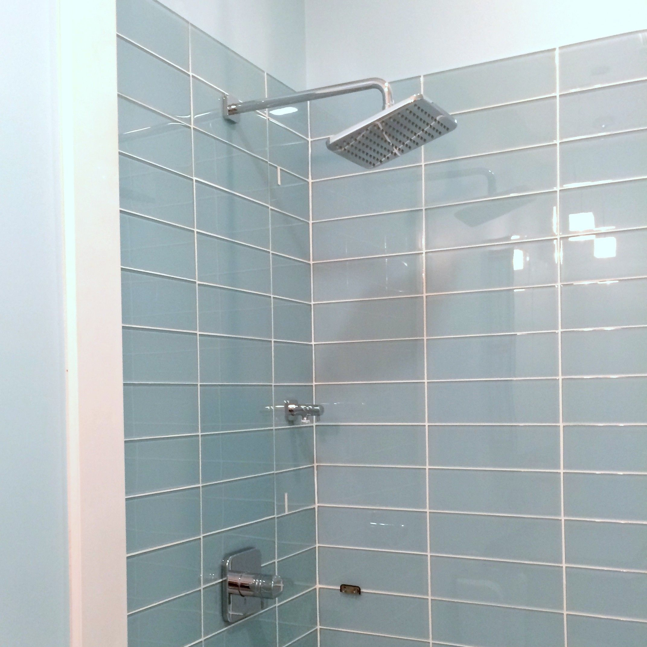 Lush vapor 4x12 pale blue glass subway tile shower How to tile a shower