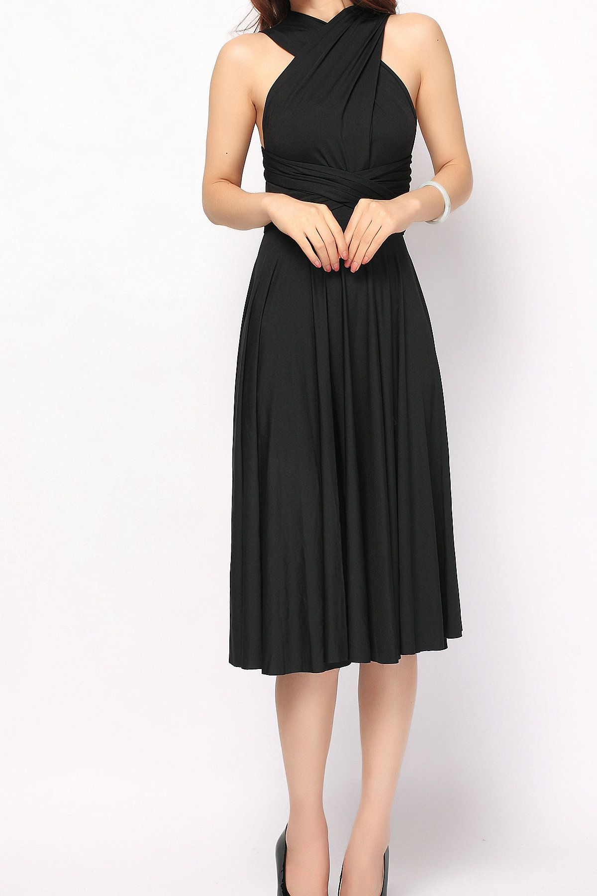 Black convertible dress. Perfect for travel. Many dresses in one!