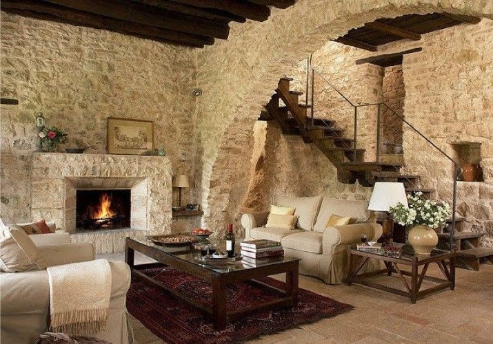 Casali e rustici di stile - Salotto con pareti pietra  House
