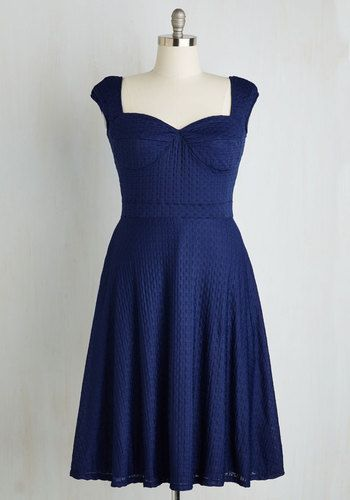 Simply arriving in this navy blue dress by Bettie Page shows fellow dance hall attendees you've got style. Now, scoot this retro midi to the floor and verify what they suspect - that this textured knit frock pairs flawlessly with some stellar moves!