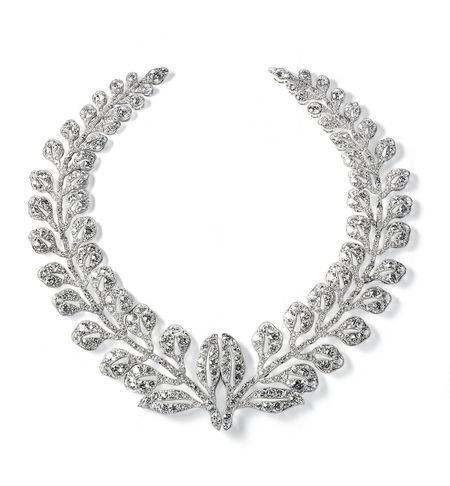 Fern-Spray brooch, Cartier Paris, 1903, Platinum, round old-cut diamonds, millegrain setting, Sold to Sir Ernest Cassel Sir Ernest Cassel (1852–1921) was a friend and private financial adviser to King Edward VII of England. In 1922 his granddaughter, the