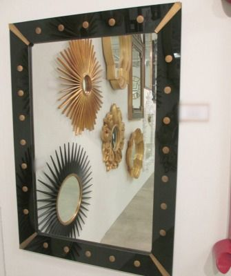 the detail on our black and brass mirror is so gorgeous!