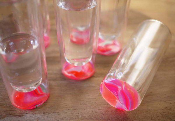 DIY Marbled Glassware. It's a super great way to refresh your boring and plain glasses  to a fashionable addition to your next table centerpieces during a party with the bright and bold colors of the nail polish.