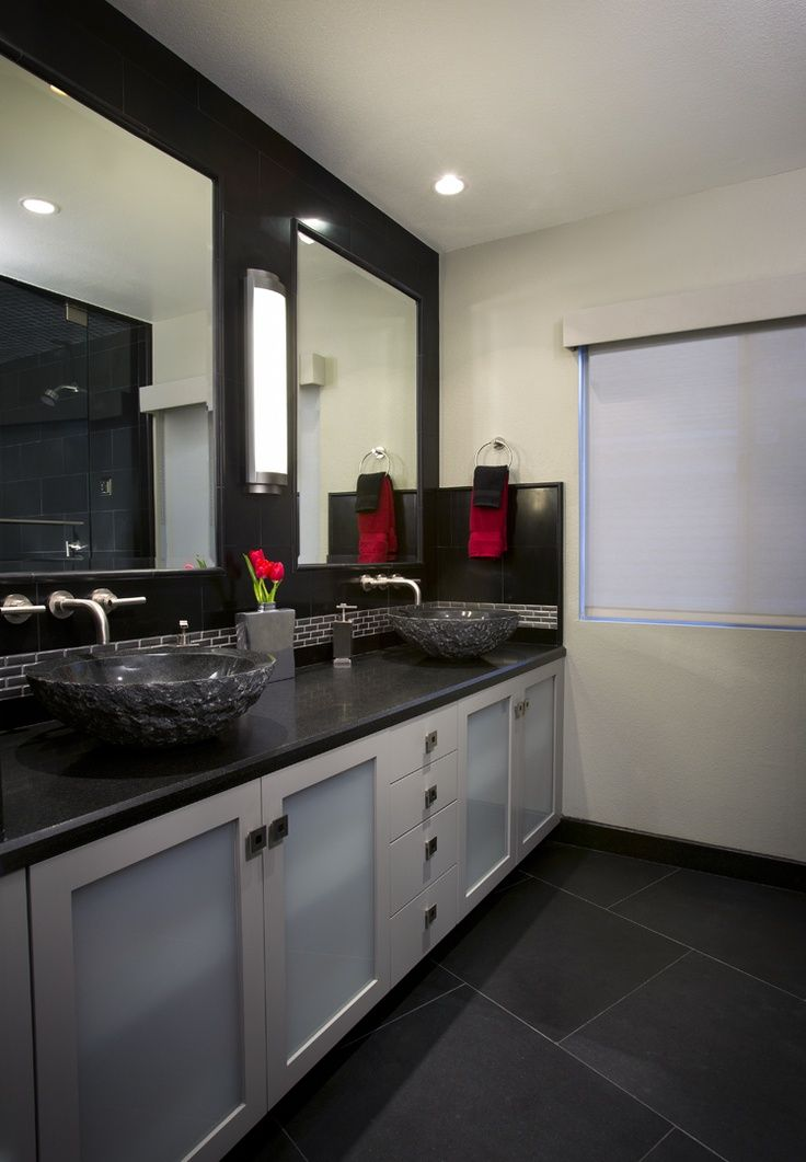 The Black And Grey Tiles In This Bathroom Along With The