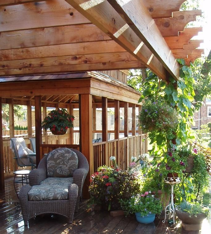 A Pergola And A Solid Roofed Structure Over A Deck Brings