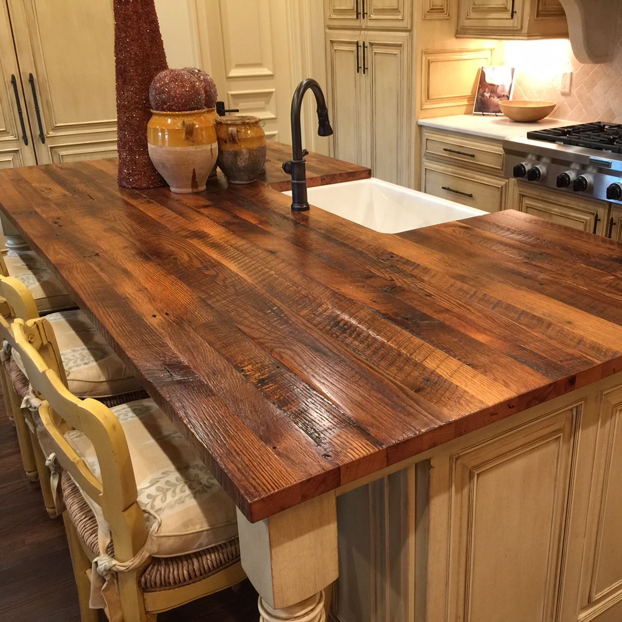 A Refined Rustic Kitchen Adds An Authentic Island Top Made From Reclaimed Oak The Surfac Kitchen Island Countertop Wood Kitchen Island Farmhouse Style Kitchen