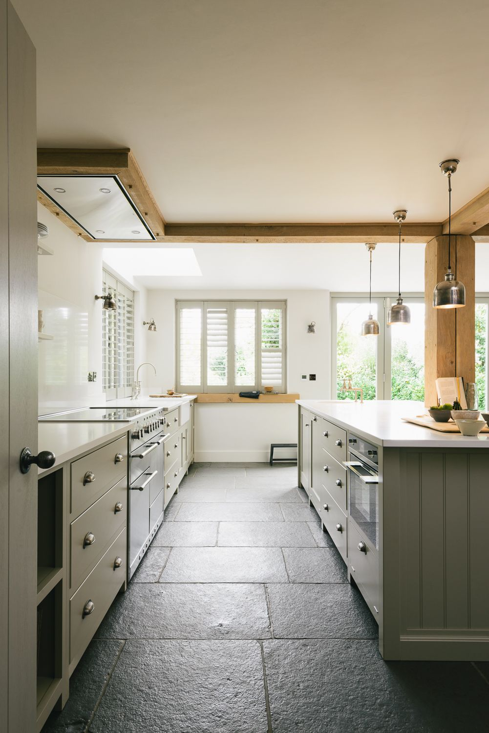 Stone flooring simple shaker cupboards and a beautiful mercury