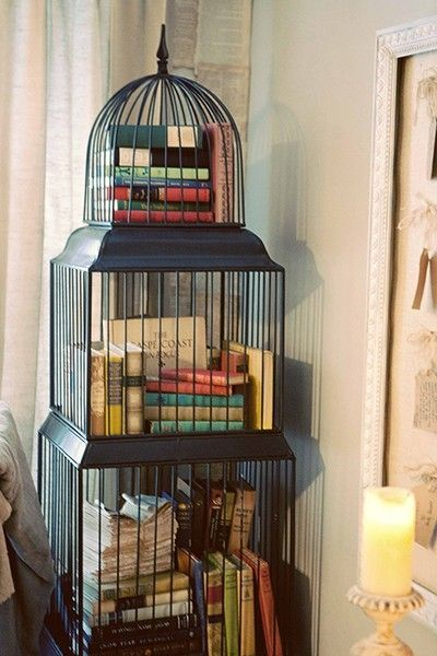 A birdhouse filled with books #literarydecor