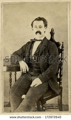 CIRCA 1864 - A vintage Cartes de visite photo of a gentleman. The man is sitting with one arm on the arm of the chair. A photo from the Civil War Victorian era. A digital copy of this photo can be purchased at the above web link.
