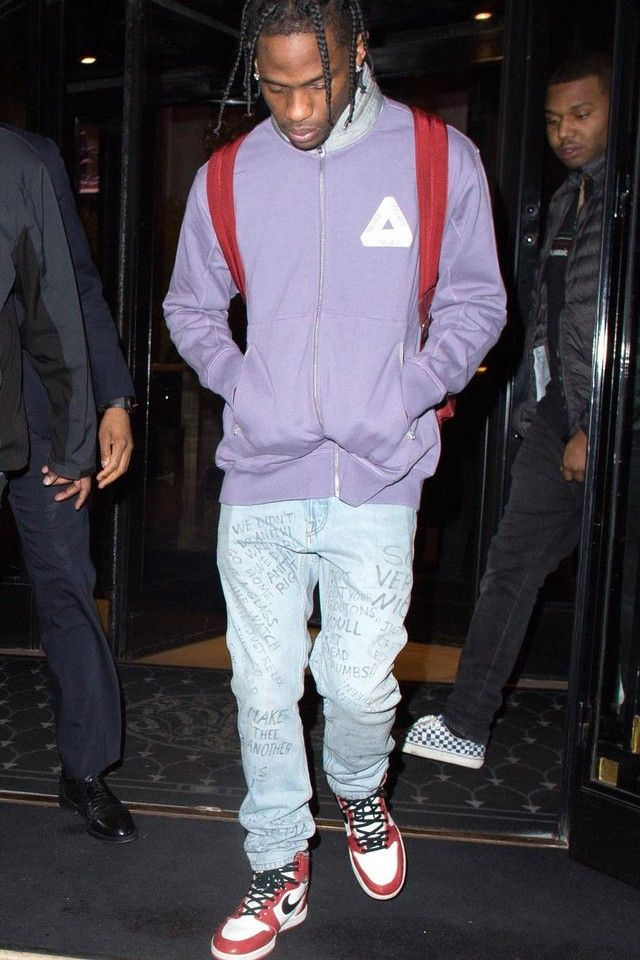 267ceca4d9b Travis Scott wearing Gucci Scribbled writing print punk pant, Palace Full  Zip Jacket, Jordan 1985 1 Sneakers