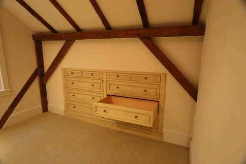 built in drawers for sloped ceiling, storage area