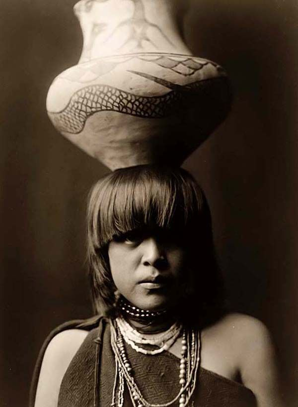 Indian Girl with a Jar on her head. It was taken in 1927 by Edward S. Curtis.