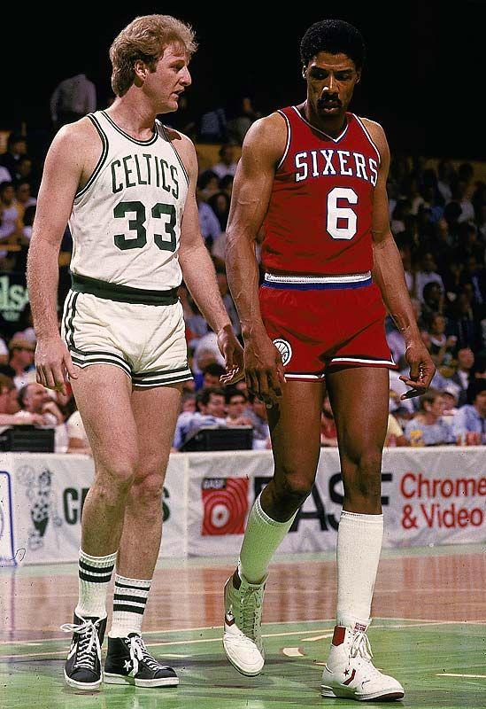 Larry Bird and Julius Erving exchange glares during a game ...