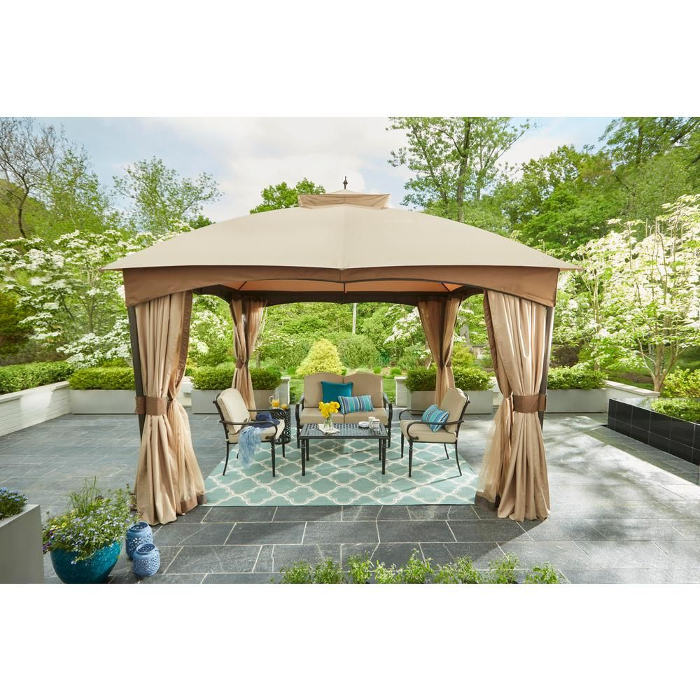 Hampton Bay Laurel Oaks 4 Piece Brown Steel Outdoor Patio Conversation Seating Set With Standard Putty Tan Cushions 505 0370 000 Patio Gazebo Gazebo Patio Shade